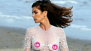 Cindy Crawford Ditches Her Bra While Modeling a Completely Sheer Dress on the Beach: See the Sexy Photos!