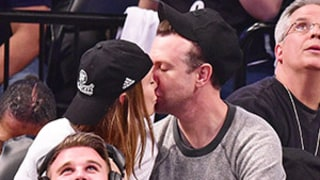 Olivia Wilde, Jason Sudeikis Kiss Courtside at Brooklyn Nets Game: Photos