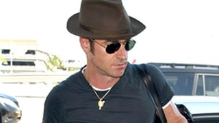 Justin Theroux (and His Muscles!) Jet Out of LAX, Returns to Work Following Honeymoon -- See His Wedding Band!