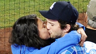 Mila Kunis, Ashton Kutcher Share Passionate Kiss at Dodgers Game — See the Cute Pics