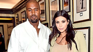 Kim Kardashian's Latest Pregnancy Style Includes Thigh-High Boots and a Ruffled Skirt
