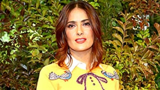 Salma Hayek Looks Smoking Hot in Bold Sweater and Tight Leather Skirt: Milan Fashion Week Pics