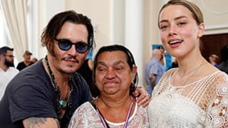 Amber Heard in Tears as She and Johnny Depp Hand Out Hearing Aids: Photos