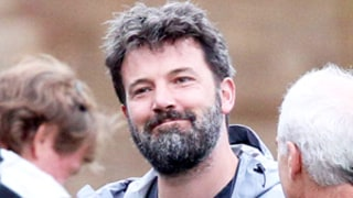 Ben Affleck Grins, Is Bushy-Bearded as He Returns to Boston: Photos