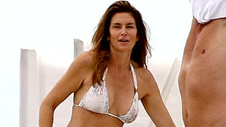 Cindy Crawford Shows Off Her Sexy Body in Snake-Print Bikini on the Beach