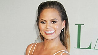 Chrissy Teigen Shows Off Tiny Baby Bump, Steps Out for First Time Since Pregnancy Announcement