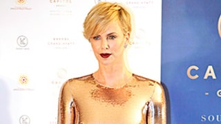 Charlize Theron Looks Like She's Been Dipped in Metal in Skintight Gold Dress — and We Can't Look Away