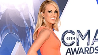 Carrie Underwood Stuns in Coral Peplum Gown on the 2015 CMA Awards Red Carpet