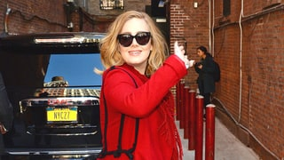 Adele Ditches the All-Black Ensembles in Favor of a Stunning Red Coat