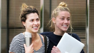 Amber Heard Smiles as She Puts Arm Around Friend One Day After Getting Restraining Order Against Johnny Depp