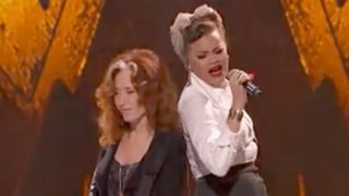 Watch Bonnie Raitt, Andra Day Duet on Fiery 'Love Sneakin' Up on You'