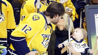 Carrie Underwood Kisses Husband Mike Fisher Rinkside While Baby Isaiah Looks On