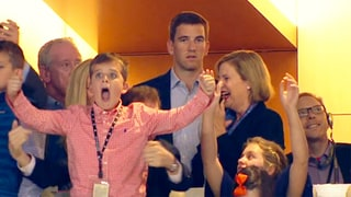 Eli Manning Explains His Stoic Reaction to Big Brother Peyton's Super Bowl-Clinching Touchdown Drive