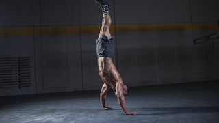 Why Mastering the Handstand Will Give You Stronger Abs