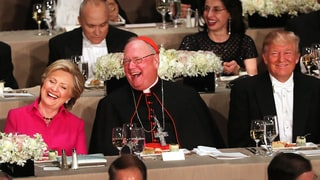 Watch Trump Get Booed While Roasting Clinton at Catholic Charity Event