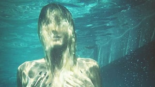 Heidi Klum Poses Topless Underwater in Series of Sultry Bikini Photos