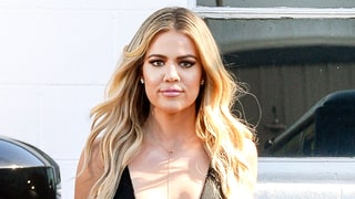 Khloe Kardashian Wears Two Plunging Bodysuits With Intensely Distressed Jeans