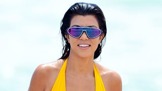 Kourtney Kardashian Keeps Summer Alive in Sexy Yellow Plunging One-Piece While Out With Scott Disick