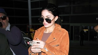 Kylie Jenner Adds Bling to Body-Conscious Airport Style With One Huge Diamond