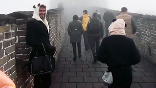 Liam Hemsworth Carried Jennifer Lawrence's Valentino Purse Up the Great Wall of China While Wearing a Panda Hat