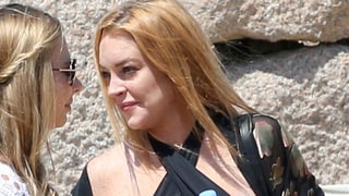 Lindsay Lohan Almost Bares Her Breasts in Skimpy Halter Top as She Ditches Her Engagement Ring