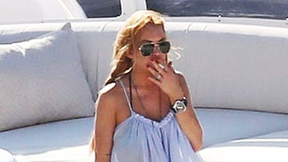 Lindsay Lohan Spotted Lounging in a Bikini, Smoking Aboard a Yacht Amid Pregnancy Rumors
