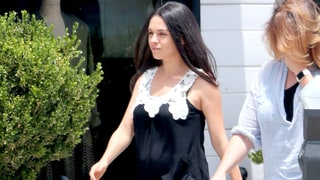 Pregnant Mila Kunis Shows Off Her Baby Bump in a Lace Top, Skinny Jeans