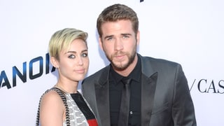 Miley Cyrus and Liam Hemsworth Ring in the New Year With a Sweet Kiss