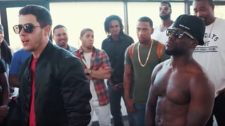 Watch Nick Jonas, Kevin Hart Face Off in Ridiculous Rap Battle