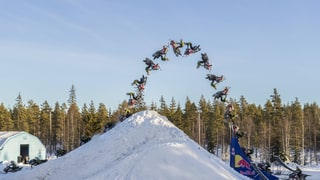 Watch This Guy Do a Freaking Double Backflip On a Snowmobile
