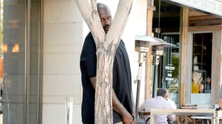 You Need to See This Hilarious Photo of Shaquille O'Neal Trying to Hide Behind a Tree