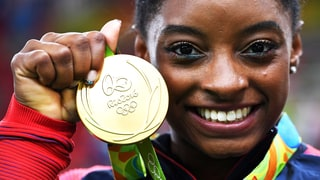 Simone Biles Made Sure to Take Her Gold Medal With Her on Fire Drill