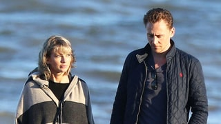 Taylor Swift and Tom Hiddleston Hold Hands as They Walk Along the Beach in England
