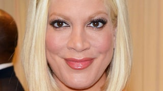 Tori Spelling Shows Off Her Growing Baby Bump in a Skintight Dress