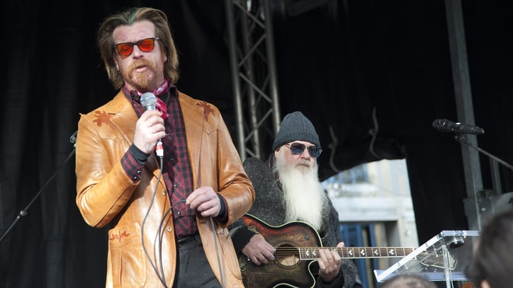Watch Eagles of Death Metal's Solemn Return to Paris' Bataclan Memorial