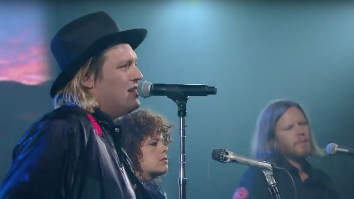 Watch Arcade Fire Perform Two Songs, Mock Consumerism on 'Colbert'