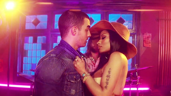 See DNCE, Nicki Minaj Play Spin the Bottle in 'Kissing Strangers' Video