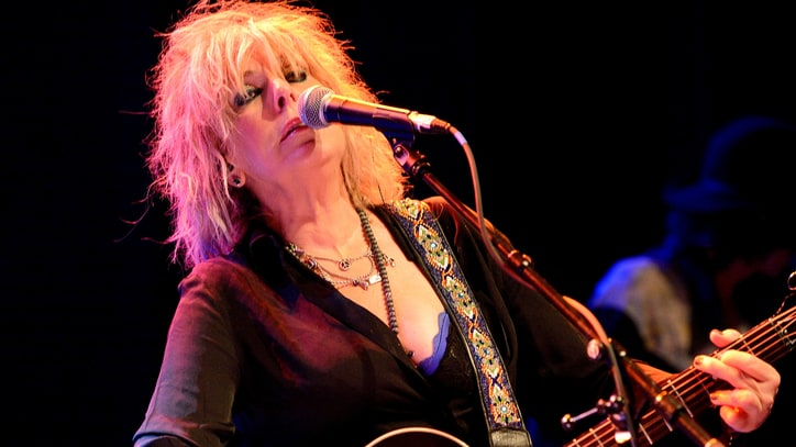 Hear Lucinda Williams' Mournful New Recording of 'Sidewalks of the City'