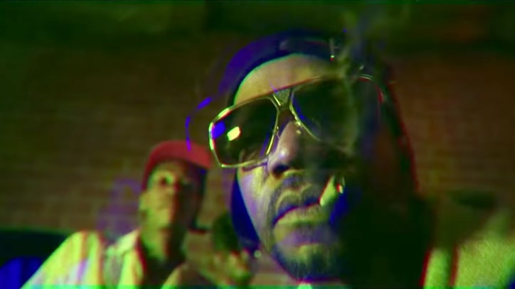 Watch Juicy J Hawk New Weed Strain in Psychedelic 'Green Suicide'