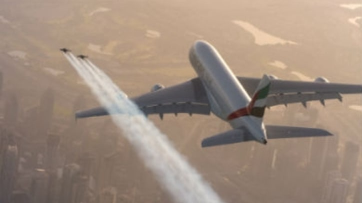 Watch Two Jetpack Pilots Fly Ridiculously Close to an Airbus