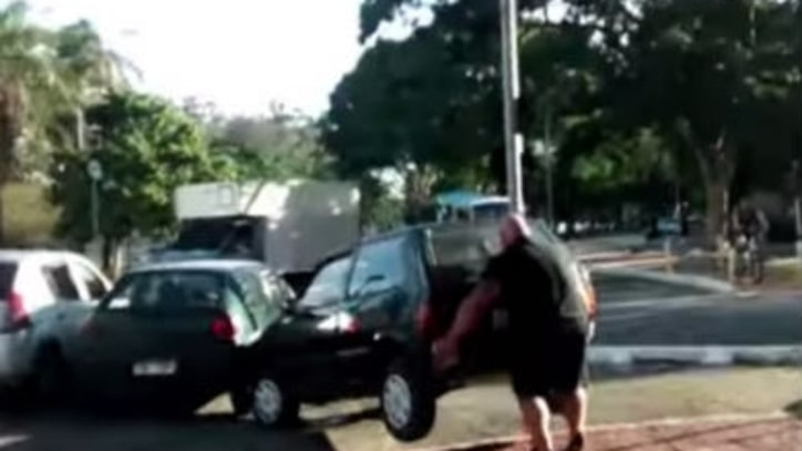 Watch a Brazilian Strongman Remove a Car Blocking His Bike Lane