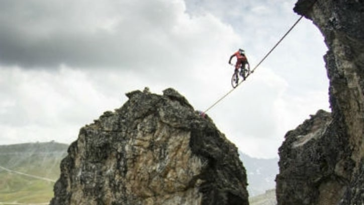 Watch a Mountain Biker Ride a Slackline Above a 367-Foot Drop