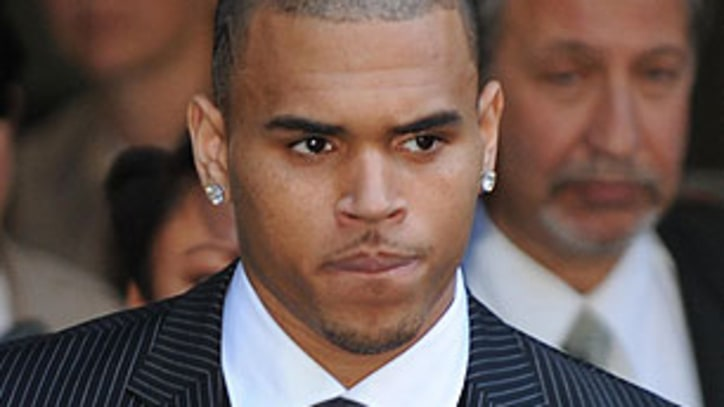 Rihanna Agrees to Downgrade Restraining Order Against Chris Brown