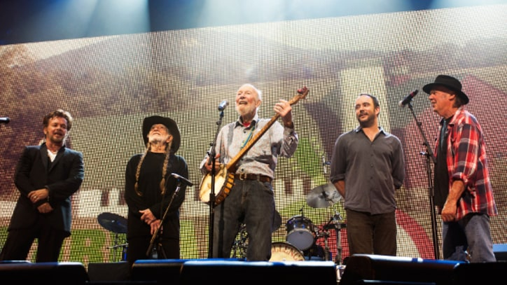 Neil Young, Dave Matthews, Jack Johnson Triumph At Soggy Farm Aid