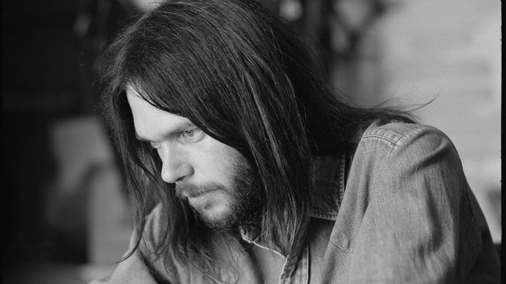 Neil Young Goes Solo on 'Live at the Cellar Door' – Album Premiere