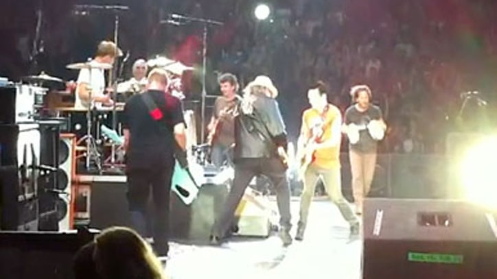Pearl Jam and Neil Young Perform 'Rocking in the Free World'
