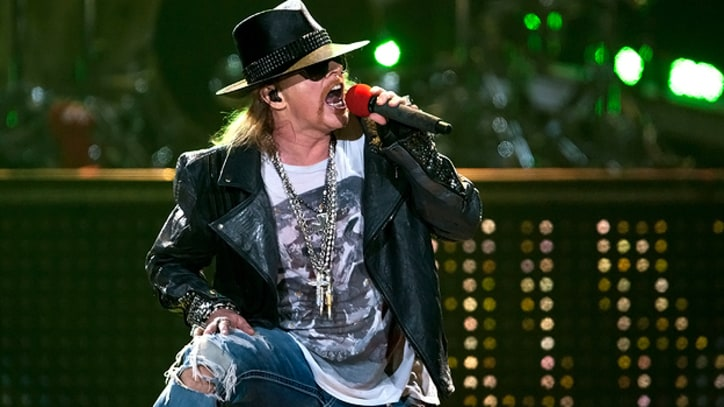 Axl Rose Takes a Tumble Onstage in France