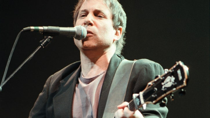 Flashback: Paul Simon Reunites With Chevy Chase at 1991 Concert in the Park