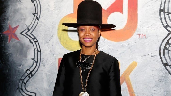 Erykah Badu Tries to Steal a Kiss From Local News Reporter on Live TV