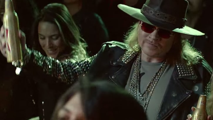 Axl Rose Makes Bizarre Cameo in Beer Commercial for World Cup